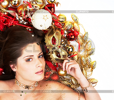 Beautiful brunette lying among cristmas decoration | High resolution stock photo |ID 3032443