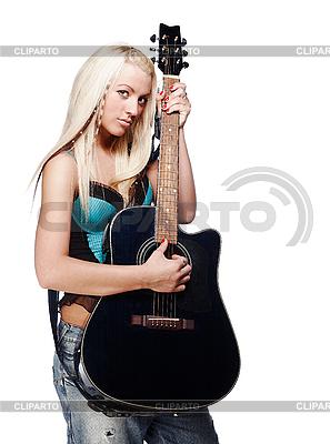 청바지를 입고 어쿠스틱 기타를 들고 십 대 소녀 | 높은 해상도 사진 |ID 3032459