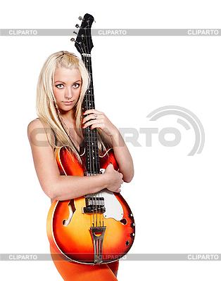 Teenage dziewczyna trzyma na gitarze basowej | Foto stockowe wysokiej rozdzielczości |ID 3032464