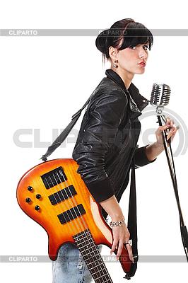 Rock-n-roll girl gospodarstwa gitara śpiew | Foto stockowe wysokiej rozdzielczości |ID 3032473
