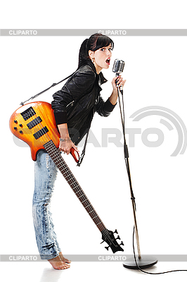 Rock-n-roll girl holding guitar singing into microphone | High resolution stock photo |ID 3032474