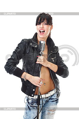 Beautiful rock-n-roll girl singing into retro microphone | High resolution stock photo |ID 3032479