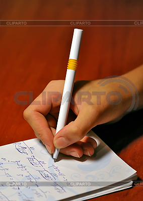 Hand of girl with ballpoint pen. Lessons | High resolution stock photo |ID 3023950