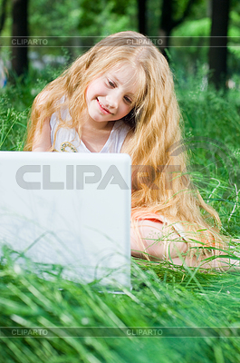 Serious looking little girl with laptop   High resolution stock photo  ID 3284697
