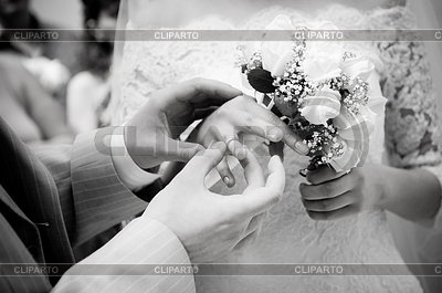 Close-up of newly-married putting on rings | High resolution stock photo |ID 3288315