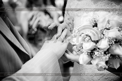 Close-up of newly-married putting on rings | High resolution stock photo |ID 3310248