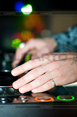 Close-up of deejay's hand and turntable | High resolution stock photo |ID 3320449