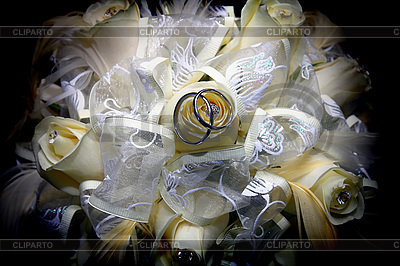 Wedding rings and bouquet | High resolution stock photo |ID 3041240