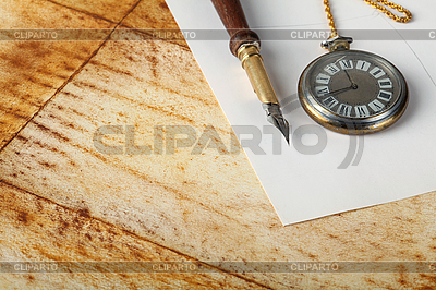 Old calligraphy pen on paper and watch | High resolution stock photo |ID 3059836