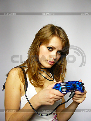 Attractive brown-haired woman plays video game | High resolution stock photo |ID 3048978