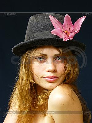 Girl in hat with flower | Foto stockowe wysokiej rozdzielczości |ID 3051527