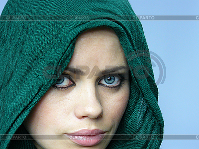 Blue-eyed girl in green linen cape | High resolution stock photo |ID 3052144