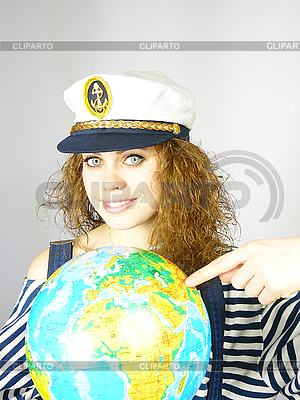 Attractive woman seafarer with the globe | High resolution stock photo |ID 3054256