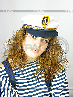 Attractive young girl in captain's cap | High resolution stock photo |ID 3054257