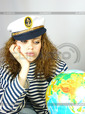 Attractive woman seafarer with the globe | High resolution stock photo |ID 3054258