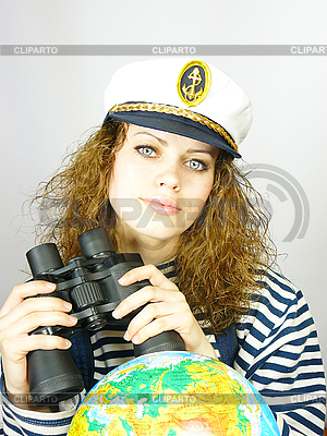 Attractive woman seafarer with the globe | High resolution stock photo |ID 3054449