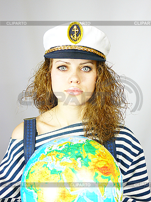 Attractive woman seafarer with the globe | High resolution stock photo |ID 3054450