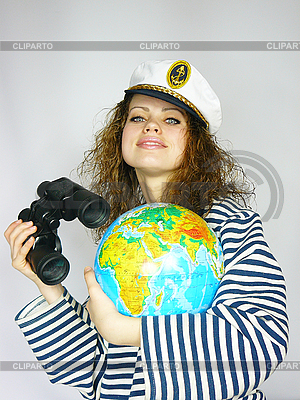 Attractive woman seafarer with the globe | High resolution stock photo |ID 3054458