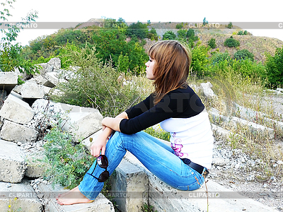 Girl has rest on concrete plate | High resolution stock photo |ID 3058031