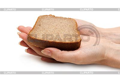 Brot in der Hand einer Frau | Foto mit hoher Auflösung |ID 3050613