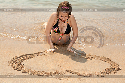 Beautiful girl painting heart on the sand   High resolution stock photo  ID 3060230