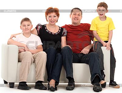 Czteroosobowa rodzina na kanapie | Foto stockowe wysokiej rozdzielczości |ID 3067164