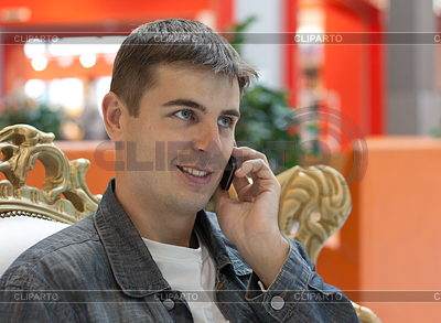Man smiles with telephone in hand | High resolution stock photo |ID 3307618
