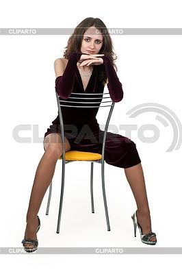 Девушка на большом стуле