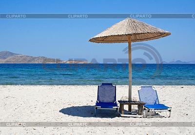 Greece. Kos island. Two chairs and umbrella on beach | High resolution stock photo |ID 3237144