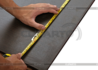 Mans hand using tape measure | High resolution stock photo |ID 3233118