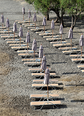 Closed Umbrellas on the Empty Beach | High resolution stock photo |ID 3118384