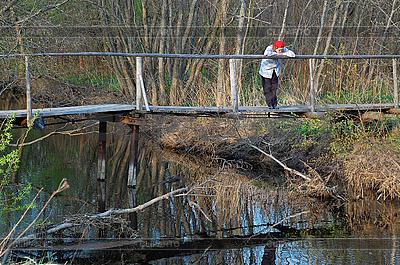 Sad Woman on Wooden Bridge in the Late Fall   High resolution stock photo  ID 3179143
