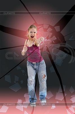 Agresywna dziewczyna przez szkło rozbija pięścią | Foto stockowe wysokiej rozdzielczości |ID 3278249
