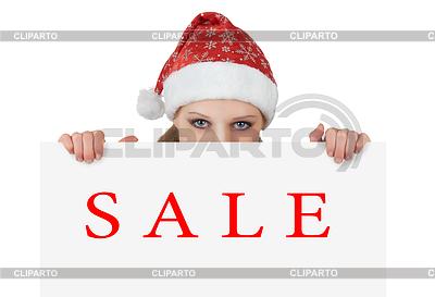 Weihnachts-Frau mit Plakat - Verkauf | Foto mit hoher Auflösung |ID 3279859