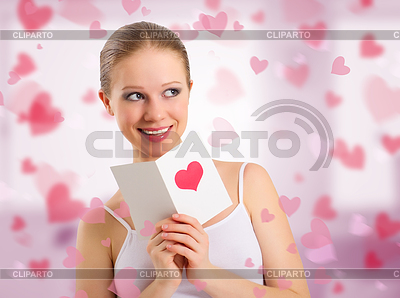 Beautiful girl reads valentine`s day card | High resolution stock photo |ID 3280006