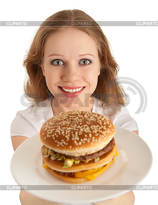 Attractive young woman holds out plate of fast food | High resolution stock photo |ID 3280146