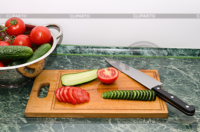 Red tomato and green cucumbers slices with knife on board   High resolution stock photo  ID 3090998
