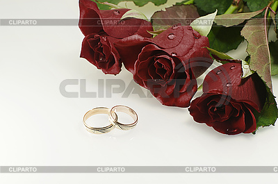 Two wedding rings with three red beautiful roses | High resolution stock photo |ID 3091588