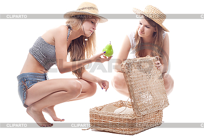 Two girls in hats with straw suitcase | High resolution stock photo |ID 3107653