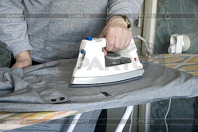 Ironing of shirt | High resolution stock photo |ID 3124283