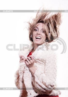 Młoda dziewczyna w futrze i słuchawki | Foto stockowe wysokiej rozdzielczości |ID 3093345