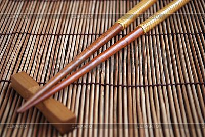 Chopsticks on brown bamboo mat | High resolution stock photo |ID 3109323