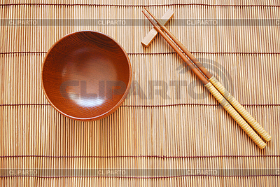 Chopsticks with wooden bowl on bamboo mat | High resolution stock photo |ID 3110681
