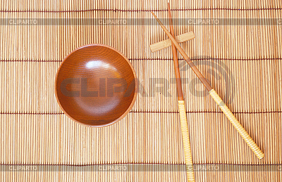 Chopsticks with wooden bowl on bamboo mat | High resolution stock photo |ID 3110684