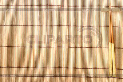 Chopsticks on brown bamboo mat | High resolution stock photo |ID 3110692