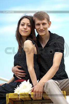 Two young people sit on bench   High resolution stock photo  ID 3113123