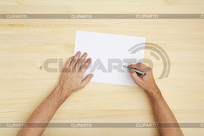 Pisanie człowiek na papierze | Foto stockowe wysokiej rozdzielczości |ID 3137284
