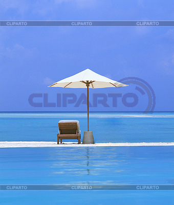 Beach Chairs and Umbrella on beautiful island | High resolution stock photo |ID 3242607