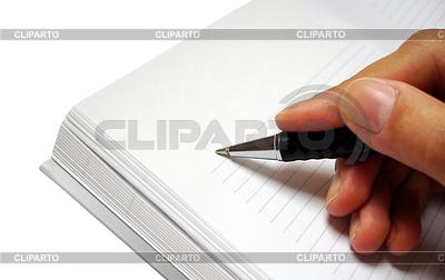 Stift in der Hand schriftlich auf Notebook | Foto mit hoher Auflösung |ID 3242818