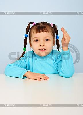 Little girl sitting at school desk | High resolution stock photo |ID 3145047